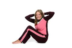 Happy young woman doing situps or crunches. Happy young woman doing crunches or situps Royalty Free Stock Photography