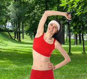 Happy young woman doing sport exercises Stock Photo