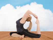 Happy young woman doing yoga exercise Royalty Free Stock Images