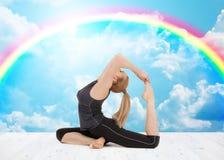 Happy young woman doing yoga exercise Stock Photo