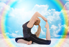 Happy young woman doing yoga exercise Royalty Free Stock Photography