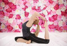 Happy young woman doing yoga exercise Royalty Free Stock Photos
