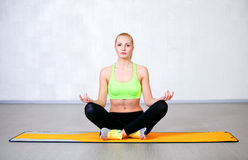 Free Happy Young Woman Doing Yoga Exercises Sitting In Lotus Position Stock Photos - 48504973