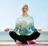 Happy young woman doing yoga outdoors Royalty Free Stock Photo