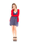 Happy Young woman in dotted dress and sweater on a Stock Photography