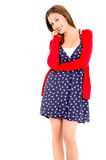 Happy Young woman in dotted dress and sweater on a Stock Images