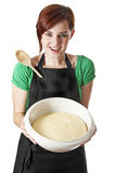 Happy young woman with a dough Stock Photos