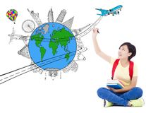 Happy young woman drawing a travel trip planning. Over white background Royalty Free Stock Images