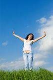 Happy young woman dreams to fly on winds Stock Photos