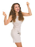 Happy young woman in dress dancing Royalty Free Stock Photography