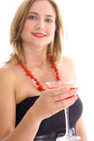 Happy young woman in dress having a cocktail Stock Image