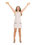 Happy young woman in dress rejoicing success Stock Photography