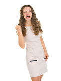 Happy young woman in dress showing yes gesture Royalty Free Stock Photos