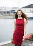Happy young woman at dress at wharf Royalty Free Stock Photography
