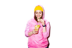 Happy young woman drinking alcoholic cocktail Stock Photography