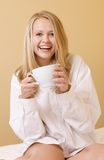 Happy Young Woman Drinking in Casual Attire Royalty Free Stock Image