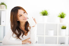 Happy  young woman drinking coffee Stock Photography