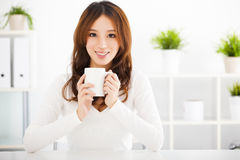 Happy young woman drinking coffee Royalty Free Stock Photo