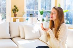 Happy young woman drinking coffee Stock Image