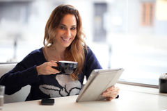 Happy young woman drinking coffee / tea  Stock Photo