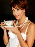 Happy Young Woman Drinking Cup of Tea Wearing Lingerie Stock Photos