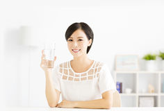 Happy young woman drinking fresh water. Happy young asian woman drinking fresh water Stock Photo
