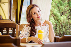 Happy young woman drinking juice Royalty Free Stock Photography