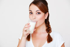 Happy young woman drinking milk Royalty Free Stock Photo