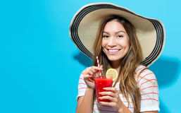 Happy young woman drinking smoothie royalty free stock photography