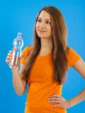 Happy young woman drinking water Stock Image