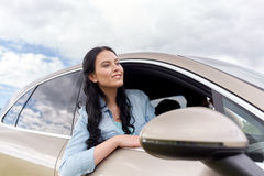 Happy young woman driving in car Stock Images