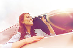 Happy young woman driving in car Royalty Free Stock Images