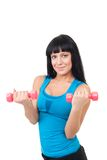 Happy young woman with dumbbells Stock Photos