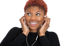 Happy young woman with earphones, listening to music Royalty Free Stock Images