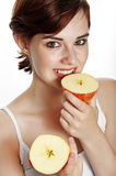 Happy young woman eating an apple Royalty Free Stock Images