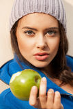 Happy Young Woman Eating Apple Royalty Free Stock Images