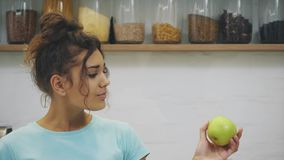 Happy young woman eating apple on kitchen. Diet. dieting concept. Healthy food. Loosing weigh. stock video