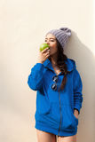 Happy Young Woman Eating Apple Stock Images