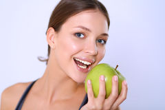 Happy young woman eating apples,  on white background Royalty Free Stock Photos