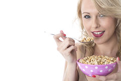 Happy Young Woman Eating Breakfast Cereals Stock Photos