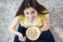 Happy Young Woman Eating Cereal Breakfast Stock Images
