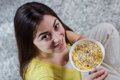 Happy Young Woman Eating Cereal Breakfast Stock Photos