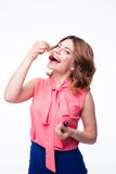 Happy young woman eating cherry Stock Images