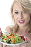 Happy Young Woman Eating Colourful Garden Salad Royalty Free Stock Images