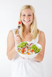Happy young woman eating fresh vegetable Royalty Free Stock Photo