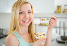 Happy young woman eating healthy breakfast Stock Image