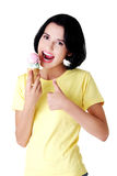 Happy young woman eating an ice cream Royalty Free Stock Photos