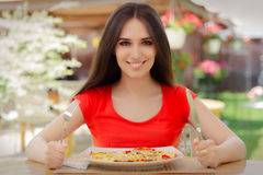 Happy Young Woman Eating Pizza Royalty Free Stock Photography