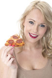 Happy Young Woman Eating Pizza Slice Royalty Free Stock Image