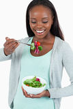 Happy young woman eating salad Stock Photos